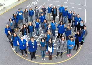 Overhead photo of Laurelwood staff standing on the playground in the shape of a  peace symbol