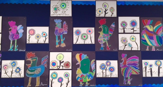 photo of 2nd grade student artwork of both Kadinsky style flowers adn chalk  roosters